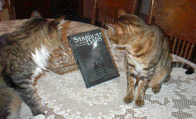Sparky and Csco with book